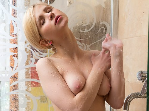 Blonde with large areolas masturbating in the shower