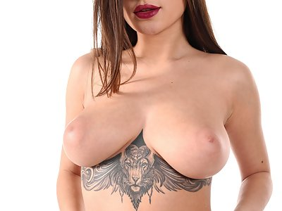Tattooed busty babe Liya Silver fingering her shaved pussy