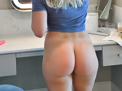 Shaved blonde with a great ass toying
