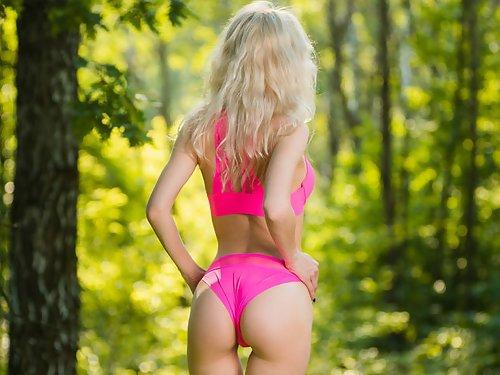 Blonde spreads her holes in a tent