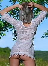 Shaved blonde teen spreading by a tree