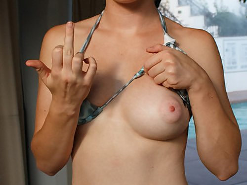 Freckled redhead flashes her perfect tits