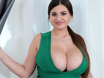 Chubby brunette shows off her huge tits