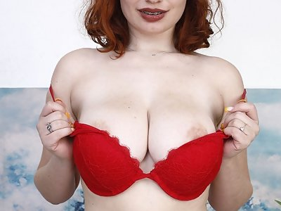 Curvy redhead with big boobs fingering her hairy pussy