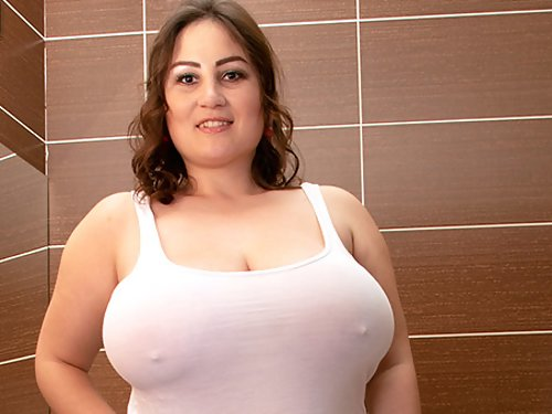 Chubby brunette with big tits toying in the bathtub