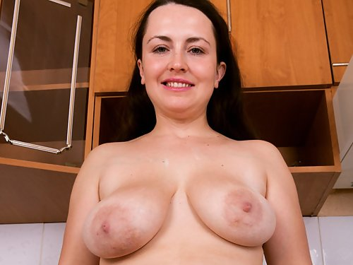 Chubby amateur with saucer nipples spreads her hairy holes