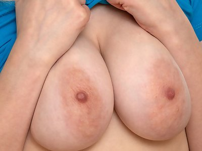 Busty blonde with large areolas masturbating