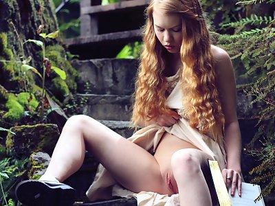 Upskirt shots of a petite redhead teen