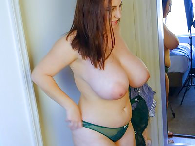 Chubby brunette with huge tits tries on lingerie