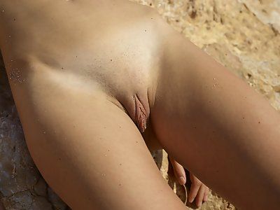 Marcelina posing under the blue sky nude