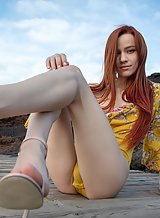 Skinny redhead spreads her hole on a mountain