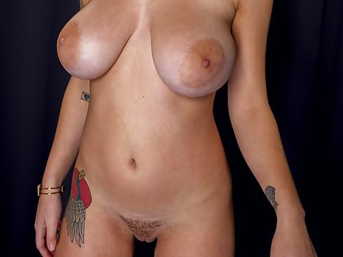 Tattooed brunette babe Gabbie Carter shows off her amazing tits