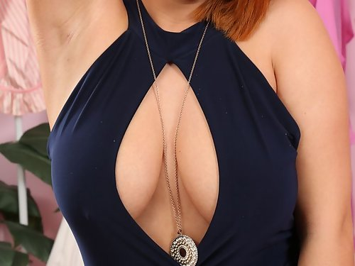 Busty redhead takes off her revealing dress
