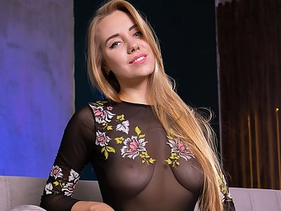 Busty blonde masturbating on a couch