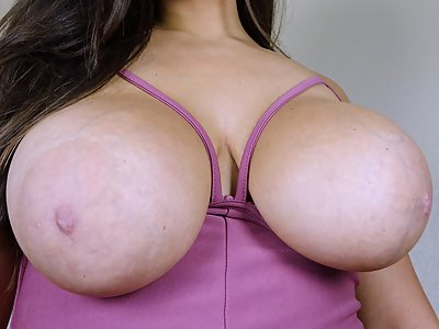Chubby brunette unleashes her huge tits