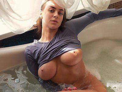 Sexy busty girl bathing