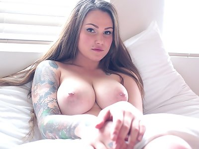 Tattooed amateur with big tits stripping in bed