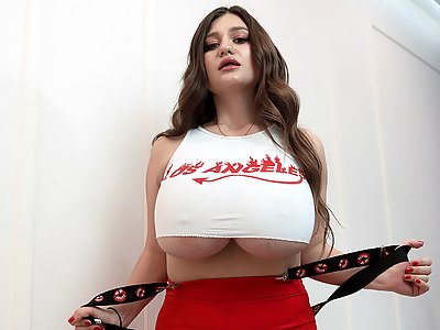 Chubby brunette shows off her enormous tits