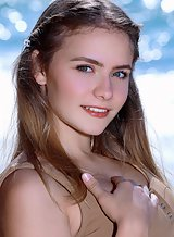 Busty teen with large areolas nude by the sea