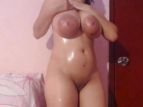 Busty girl with huge saucer nipples masturbating in bed