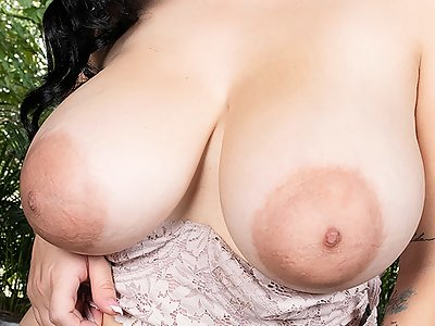 Busty Latina with saucer nipples fingering her shaved pussy