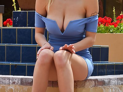 Busty blonde toying in a dress