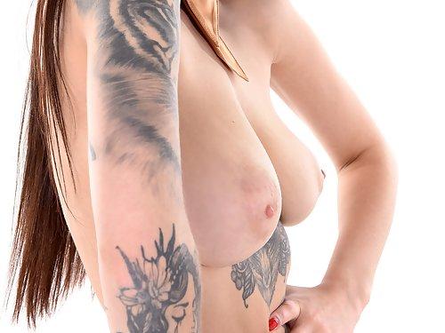 Tattooed flight attendant Tanya Bahtina shows off her big tits
