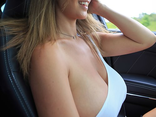 Busty brunette rubs an ice cream cone on her big boobs