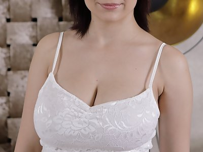 Black-haired girl shows off her big tits and pancake areolas