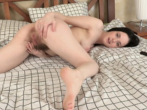 Brunette amateur with pancake areolas spreads her hairy pussy