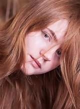 Flat-chested redhead teen in stockings