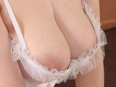 Busty blonde with pale skin takes off her lingerie