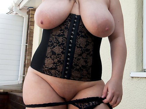 Chubby black-haired girl with big tits in lingerie