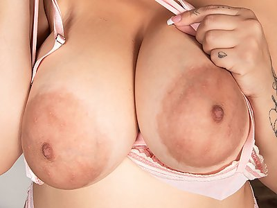 Busty Latina shows off her huge saucer nipples