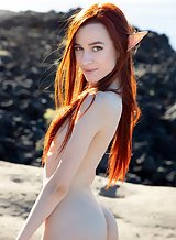 Skinny redhead spreads her ass by the sea