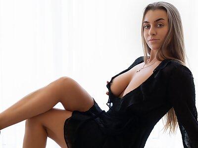 Busty babe Josephine Jackson stripping naked at Photodromm