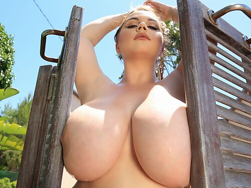 Blonde babe shows off her huge tits