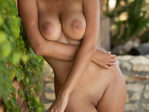 Busty blonde babe nude on the balcony
