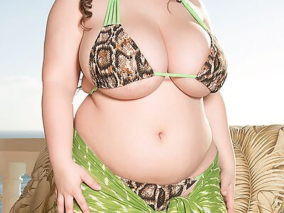 Chubby brunette with huge tits takes off her bikini