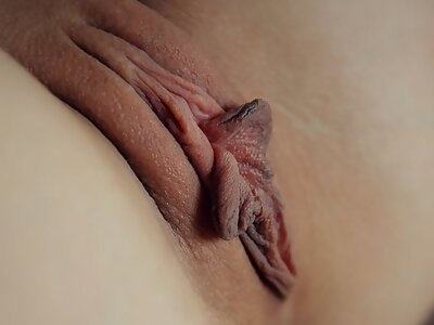 Shaved brunette exposes her big pussy lips