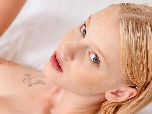 Freckled blonde teen fingering her bald pussy