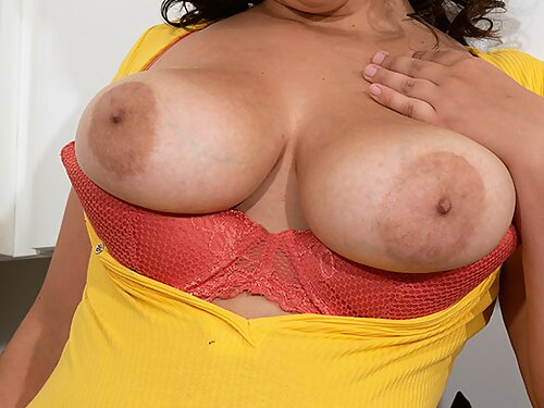 Chubby brunette flashes her big boobs