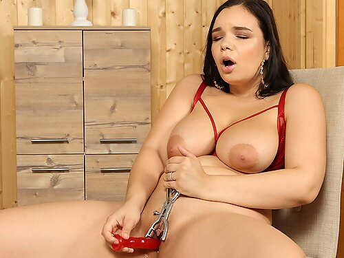 Chubby brunette with big tits toying her shaved pussy