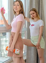 Blonde lesbians licking and fingering each other