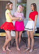 3 lesbian teens lift up their skirts