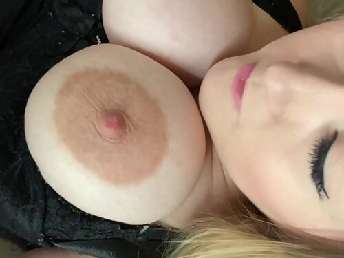 Busty blonde masturbating and playing with her saucer nipples