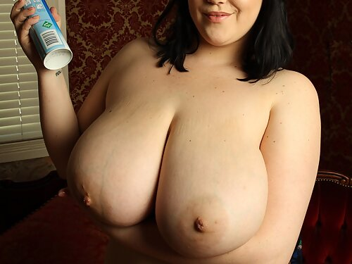 Busty BBW toying her holes