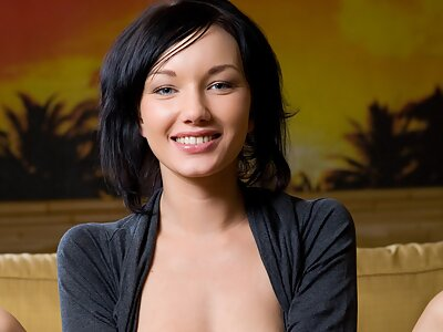 Gorgeous brunette showing off her shaved pussy