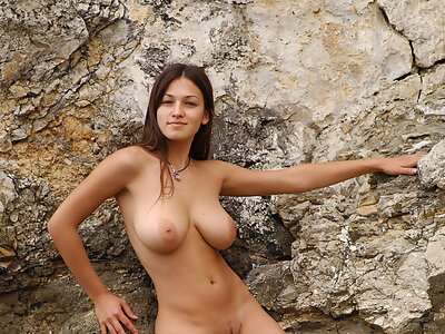 Busty brunette nude in the sea