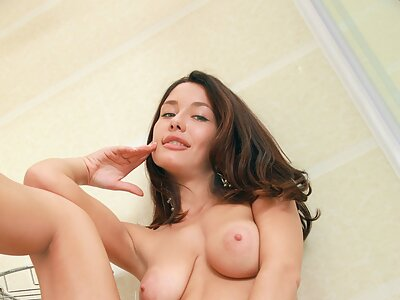 Busty brunette with big pussy lips